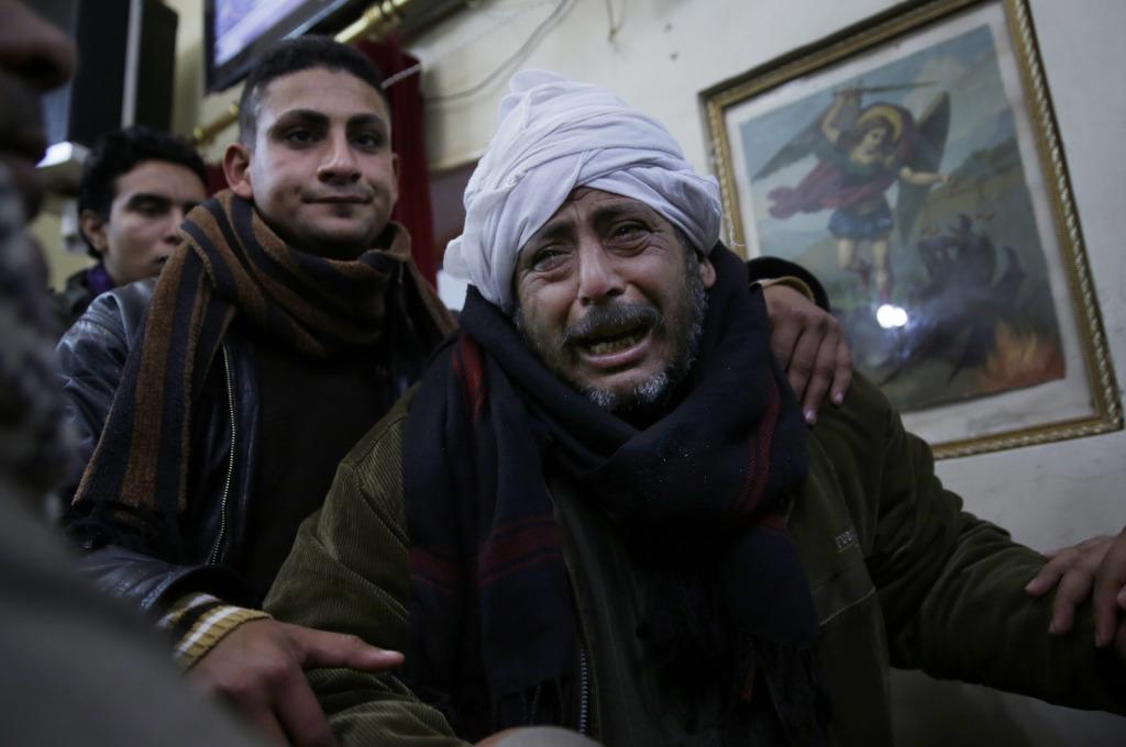 Za dvadsiatmi popravenými Egypťanmi smútili ich rodiny. FOTO - TASR