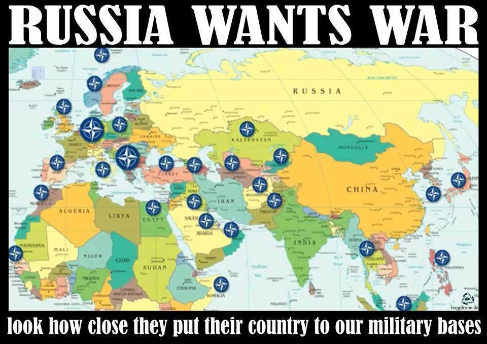"Ako základne NATO vidí proruská propaganda. ""Rusko umiestnilo svoju krajinu vedľa vojenských základní,"" ironicky hlása plagát."