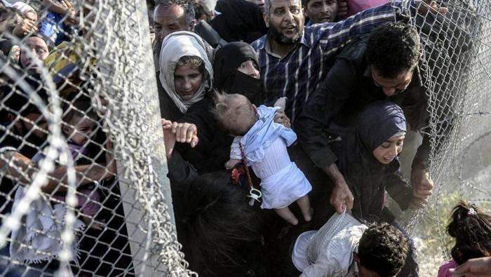 Sýrčania na tureckých hraniciach. Foto - Unicef Italia