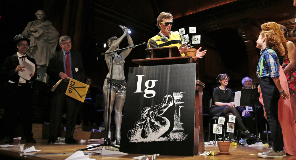 Michael Smith, a Cornell University graduate student who allowed himself to be stung about 200 times by bees to determine where you feel the most pain on the body from a sting, makes an acceptance speech while being honored during a performance at the Ig Nobel Prize ceremony at Harvard University, in Cambridge, Mass., Thursday, Sept. 17, 2015. Smith research concluded that the nostril, the upper lip and the male sex organ feel the most pain. The Ig Nobel prize is an award handed out by the Annals of Improbable Research magazine at Harvard University for silly sounding scientific discoveries that often have surprisingly practical applications. (AP Photo/Charles Krupa)