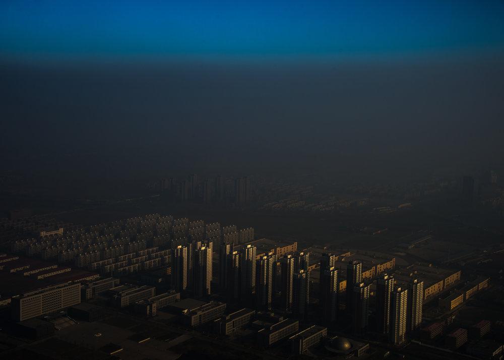 Prvá cena v kategórii problémy sveta: Opar nad Čínou. Foto – Zhang Lei