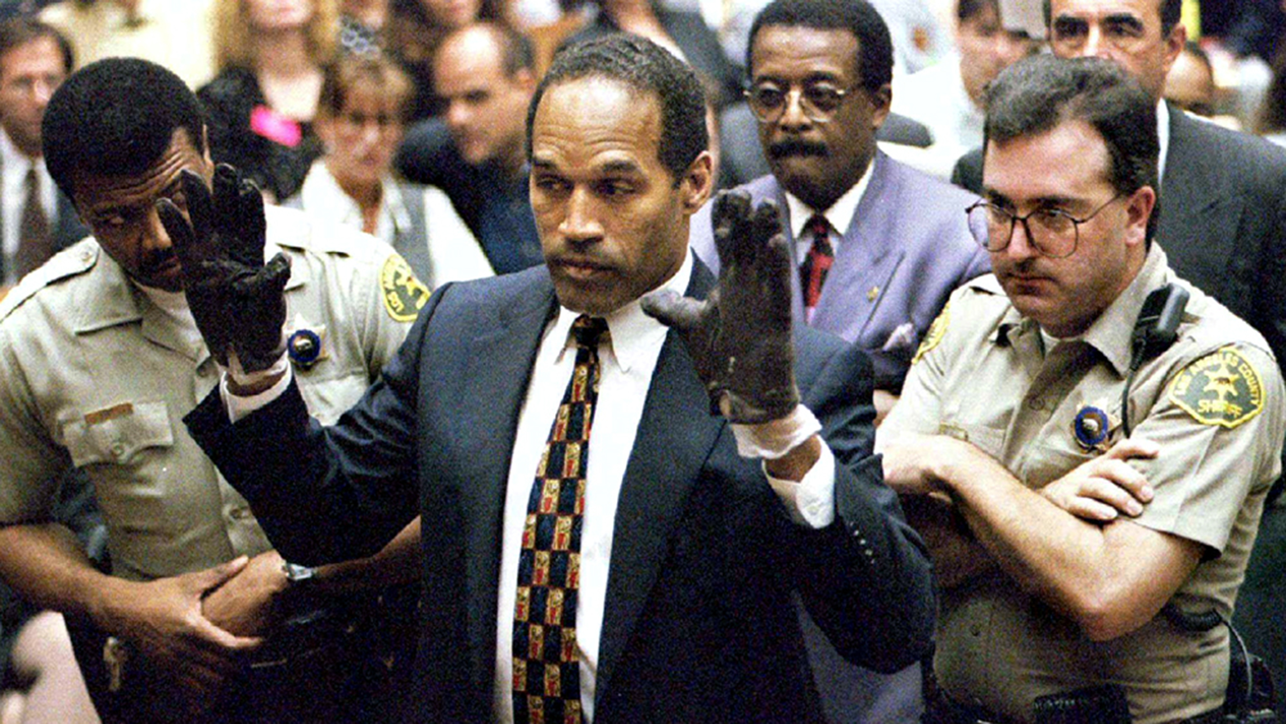 O.J. Simpson holds up his hands to the jury wearing the infamous gloves found at the crime scene and his home in this June 15, 1995 file photo. More than a decade after he was acquitted of charges that he murdered his ex-wife Nicole Brown Simpson and her friend Ron Goldman, O.J. will describe in a televised interview how he would have committed the crime if he was the one responsible in a special to air on the Fox Network November 27 and 29, 2006.