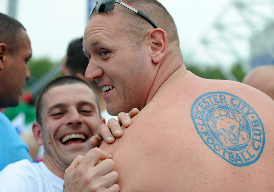 A Leicester fan wears a tattoo of Leicester City's logo before the English Premier League soccer match between Leicester City and Everton at the King Power Stadium in Leicester, England, Saturday, May 7, 2016. (AP Photo/Rui Vieira)