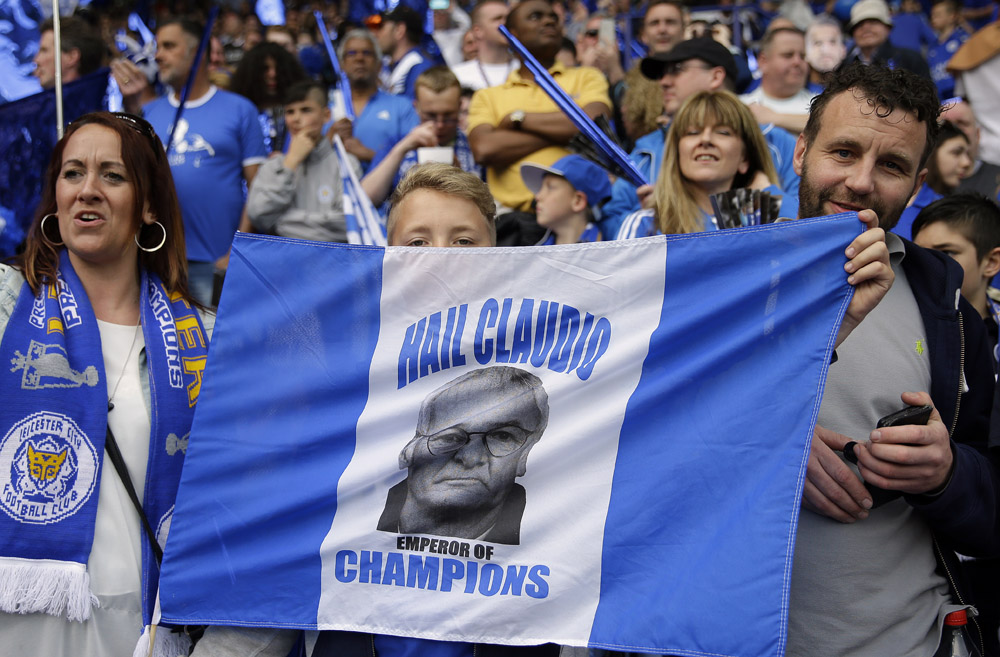 Leicester supporters stage their support for Leicester's team manager Claudio Ranieri during the English Premier League soccer match between Leicester City and Everton at King Power stadium in Leicester, England, Saturday, May 7, 2016.(AP Photo/Matt Dunham)