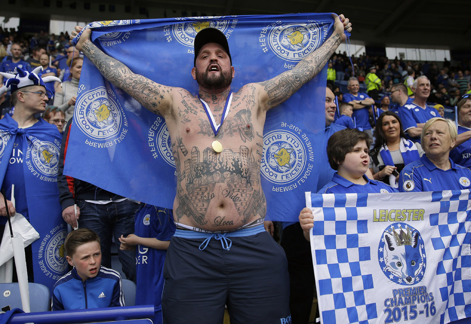 Leicester supporters cheer ahead of the English Premier League soccer match between Leicester City and Everton at King Power stadium in Leicester, England, Saturday, May 7, 2016.(AP Photo/Matt Dunham)