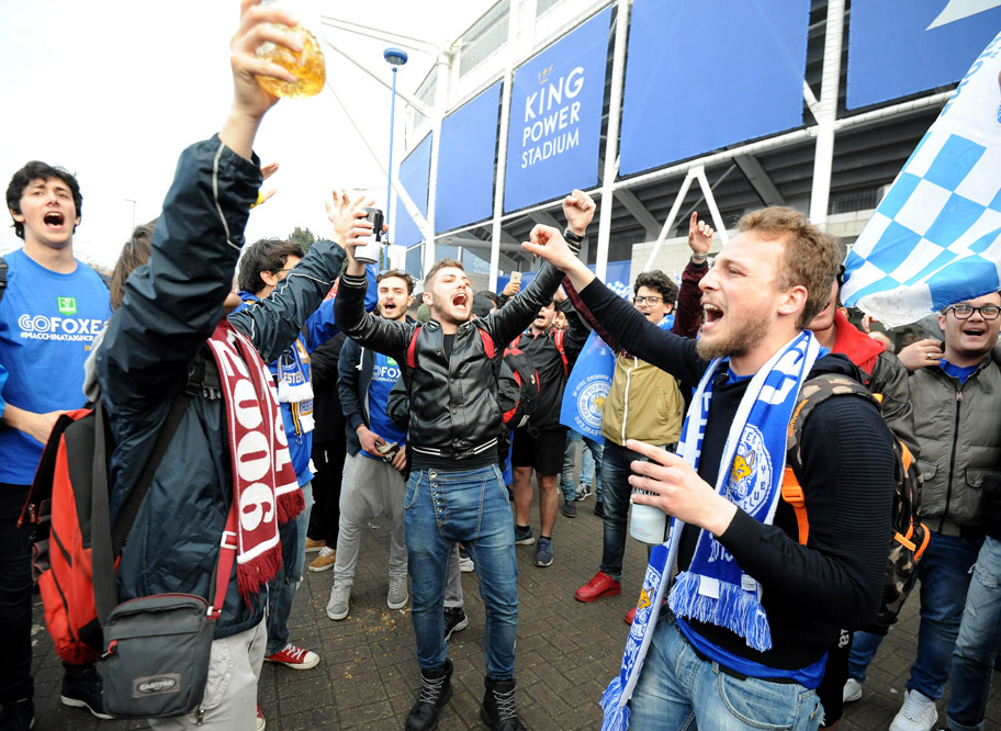 Leicester fans celebrate after the English Premier League soccer match between Leicester City and Everton at the King Power Stadium in Leicester, England, Saturday, May 7, 2016. (AP Photo/Rui Vieira)