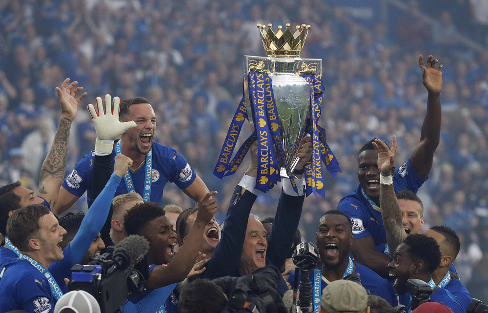 Leicester players and squad members lift the trophy as Leicester City celebrate becoming the English Premier League soccer champions at King Power stadium in Leicester, England, Saturday, May 7, 2016.(AP Photo/Matt Dunham)