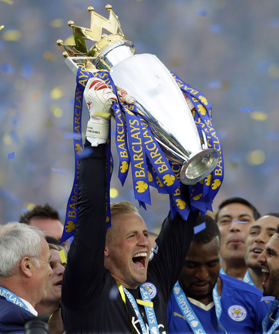 Leicester's goalkeeper Kasper Schmeichel lifts the trophy as Leicester City celebrate becoming the English Premier League soccer champions at King Power stadium in Leicester, England, Saturday, May 7, 2016.(AP Photo/Matt Dunham)