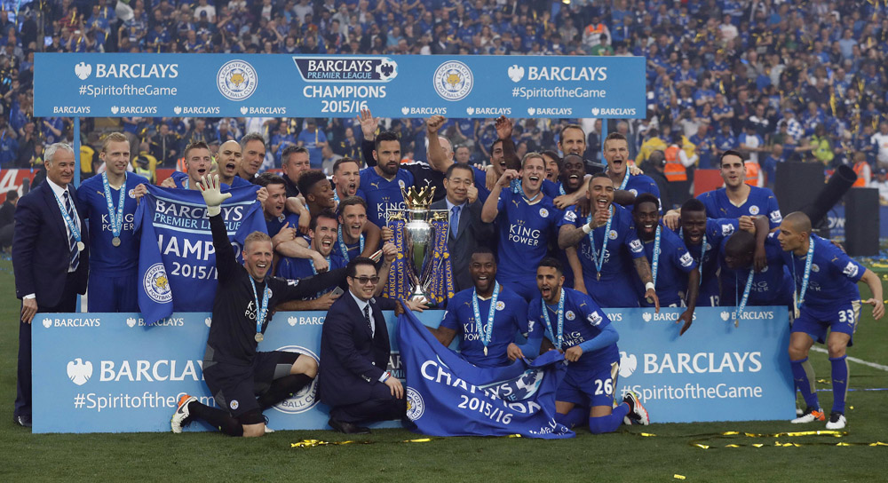 Leicester players cheer with the trophy as Leicester City celebrate becoming the English Premier League soccer champions at King Power stadium in Leicester, England, Saturday, May 7, 2016.(AP Photo/Matt Dunham)
