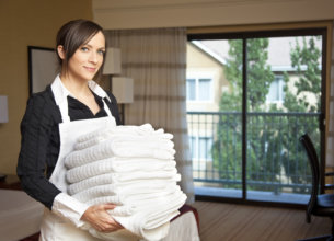 Hotel-maid with towels