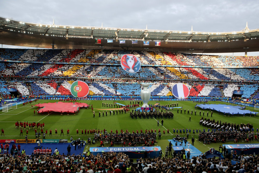 A giant replica of the trophy is seen in the middle of the pitch during the closing ceremony before the Euro 2016 final soccer match between Portugal and France at the Stade de France in Saint-Denis, north of Paris, Sunday, July 10, 2016. (AP Photo/Thibault Camus)