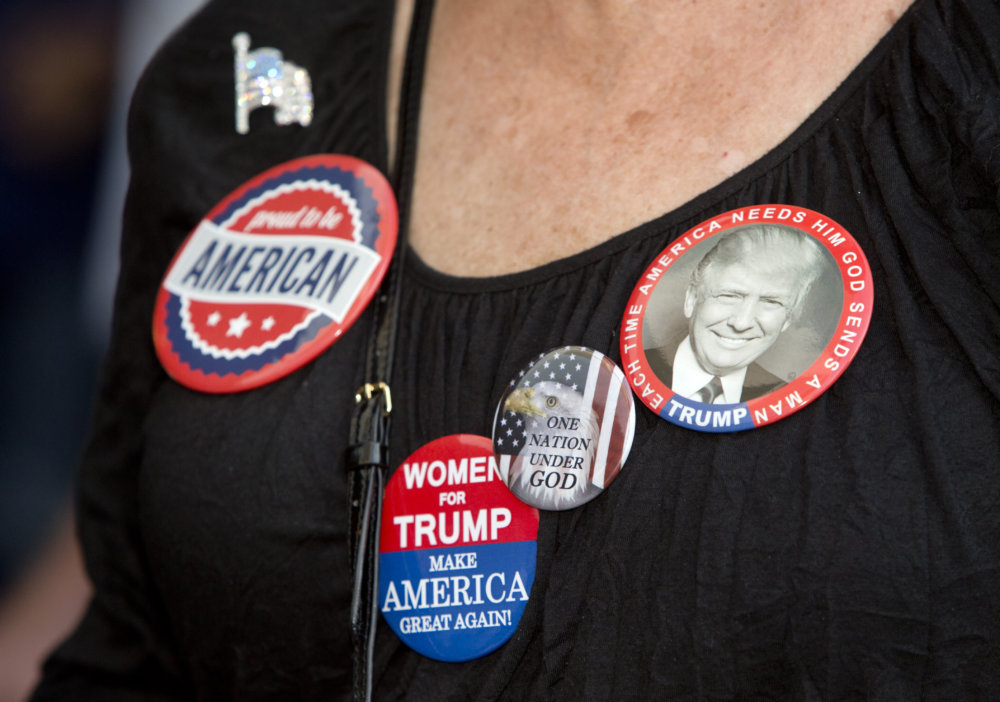 A supporters of Republic presidential nominee Donald Trump displays her campaign buttons outside the Trump International Hotel in Las Vegas Tuesday, Oct. 18, 2016. (Steve Marcus/Las Vegas Sun via AP)
