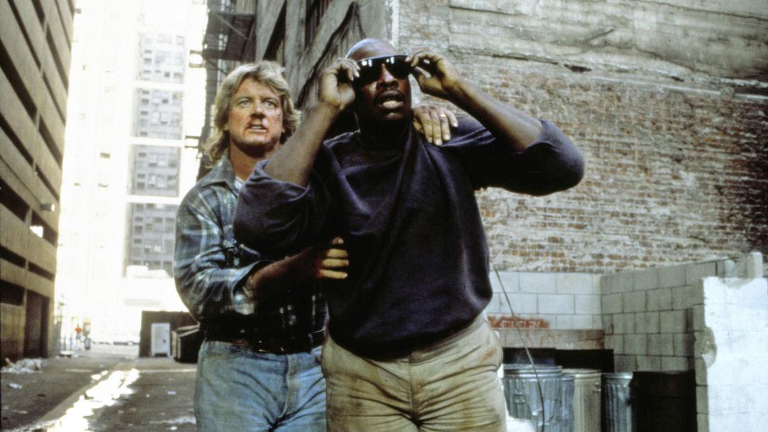Roddy Piper, Keith David *** Local Caption *** They Live, , John Carpenter, USA, 1988, V'16, Spielfilme