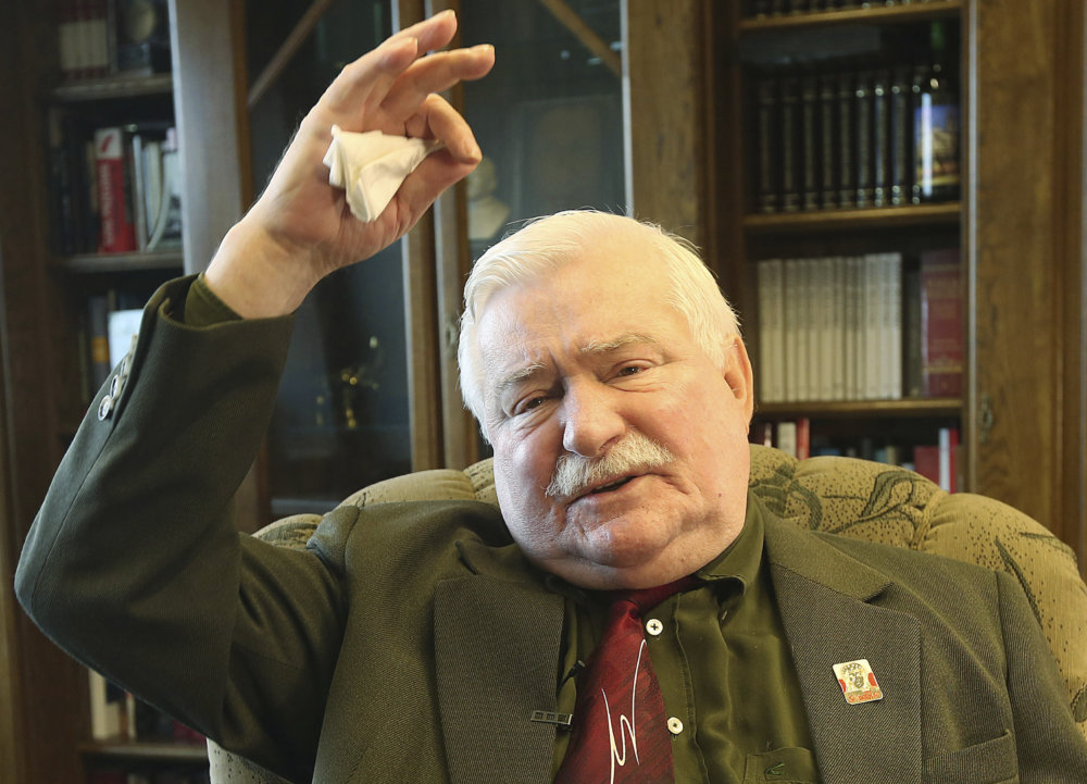 """Lech Walesa je pre Kaczyńského nepriateľ číslo jeden. Foto - tasr/ap FILE - In this file photo taken in Gdansk, Poland, April 6, 2016, Poland's former president and legendary Solidarity freedom movement founder Lech Walesa acts with expression as he repeats his denials to allegations that he collaborated with the communist regime and talks about the """"crisis of democracy"""" during an interview with The Associated Press at his new office at the European Solidarity Center in Gdansk. (AP Photo/Czarek Sokolowski, file)"""
