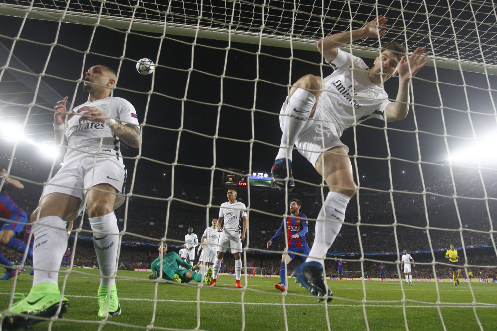 The ball bounces out of the net after Barcelona's Neymar score the opening goal during the Champion's League round of 16, second leg soccer match between FC Barcelona and Paris Saint Germain at the Camp Nou stadium in Barcelona, Spain, Wednesday March 8, 2017. (AP Photo/Manu Fernandez)